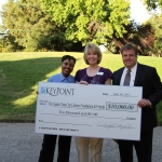 Helen Grays Jones and Brad Canfield of KeyPoint Credit Union present a check for $10,000 to Joy Hansen, Foundation Board President.