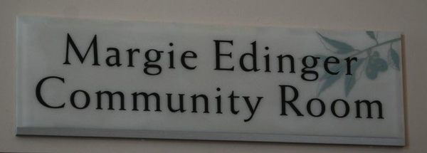 Sign hanging above the Margie Edinger Community Room