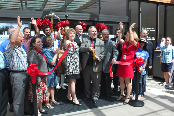 Mayor Matthews celebrates after cutting the ribbon at the grand opening of the Northside Library.